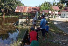 Photo of Masyarakat Rangkileh Gotong Royong Bersihkan Eceng Gondok